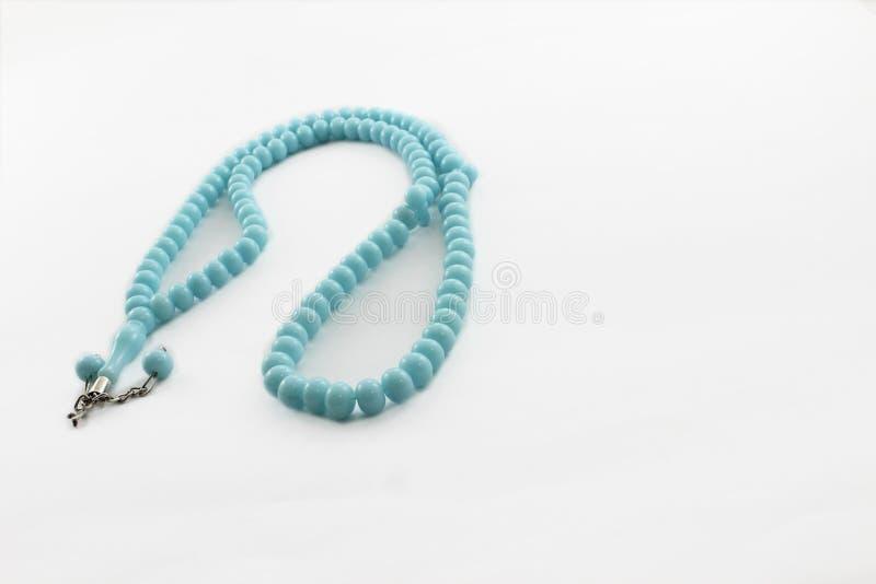 Padrenostro blu su fondo bianco fotografie stock