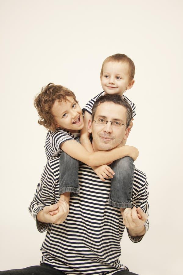 Padres con los hijos fotos de archivo libres de regalías