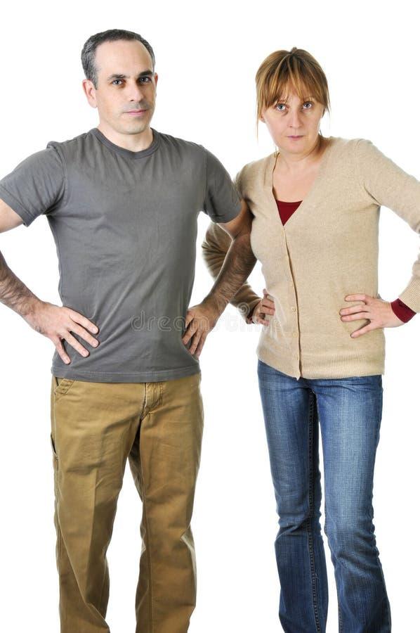 Padres severos que parecen enojados imagen de archivo libre de regalías