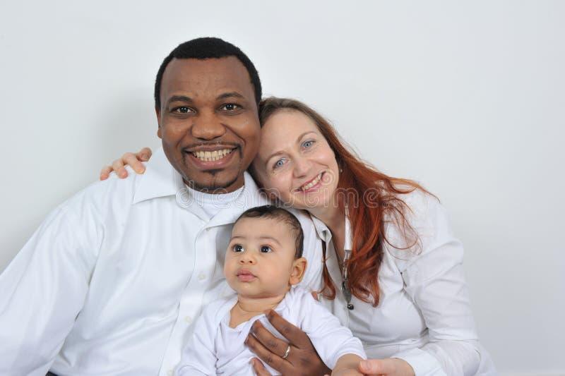 Padres y bebé felices imágenes de archivo libres de regalías