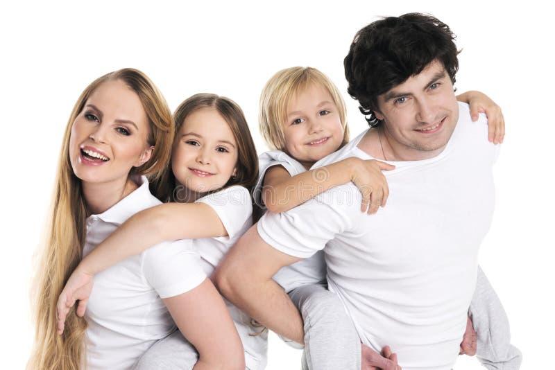Padres y dos niños imagen de archivo libre de regalías