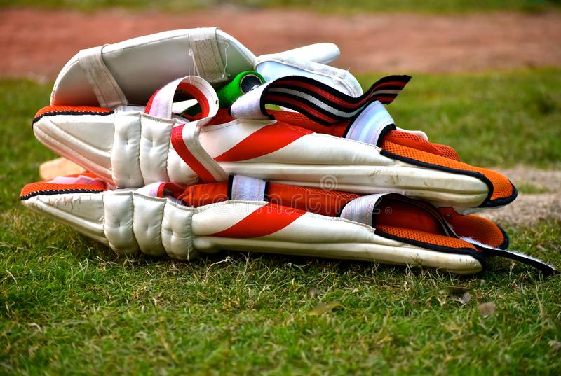 Cricket Goods Gears Stock. Cricket gears for the batsman, it`s a set of pads, thigh pads, guard and a bat which is used by a batsman while playing the stock photography
