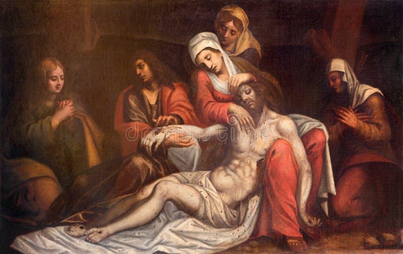 Padua - hij schildert van Pieta door onbekende venecianschilder van 17 cent in Di Santa Maria del Torresino van kerkchiesa stock afbeelding