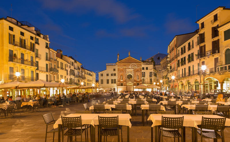 Padua - Piazza dei Signori square with the church of San Clemente in the background in evening dusk. PADUA, ITALY - SEPTEMBER 11, 2014: Piazza dei Signori royalty free stock photo
