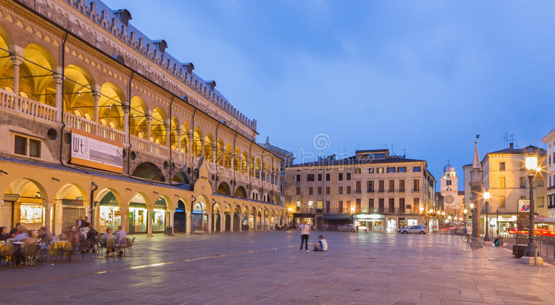 Padua - Piazza delle Erbe in evening dusk and Palazzo della Ragione. PADUA, ITALY - SEPTEMBER 9, 2014: Piazza delle Erbe in evening dusk and Palazzo della royalty free stock images