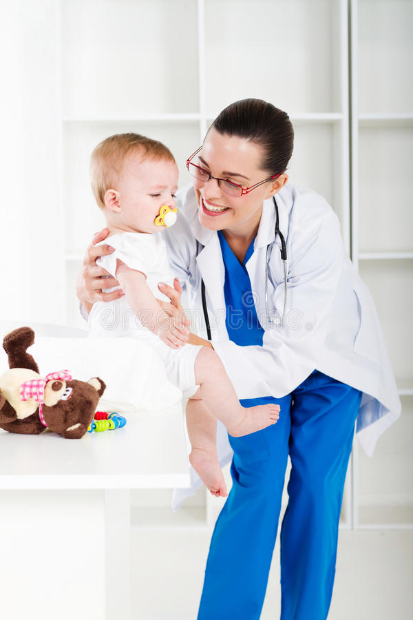 Paediatrician and baby royalty free stock image