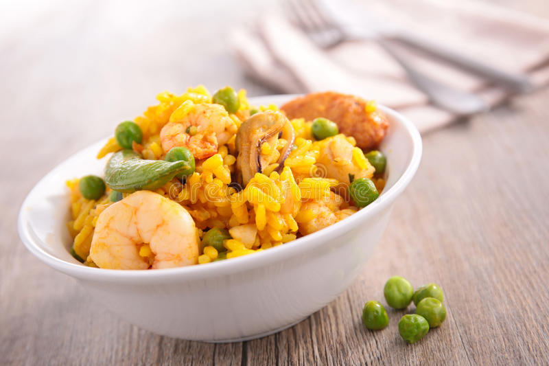 Paella. Bowl of paella with mussel and shrimp royalty free stock photos