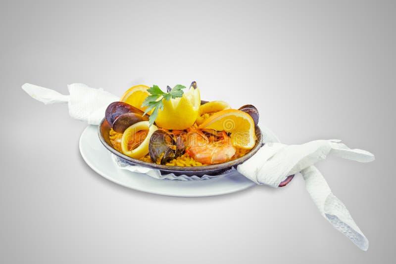 Paella española del plato fotos de archivo