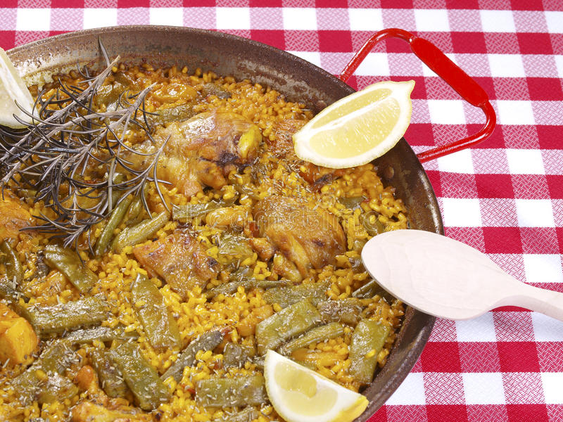 Paella in a pan. Traditional Valencian Dish. The Paella is the most worldwide well-known Valencian dish, but the gastronomy in this Spanish Region has a large royalty free stock image