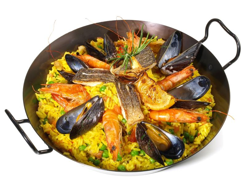 Paella in a Pan. On white Background royalty free stock photography