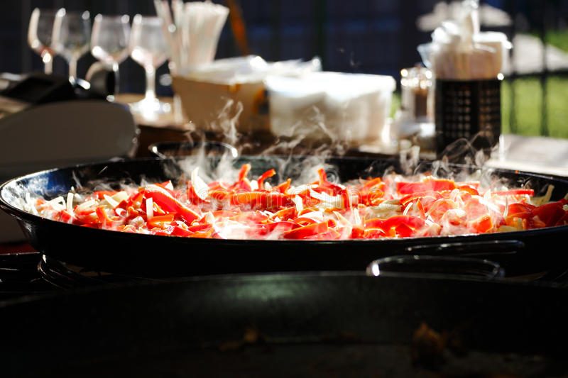 Paella in a pan steaming royalty free stock image