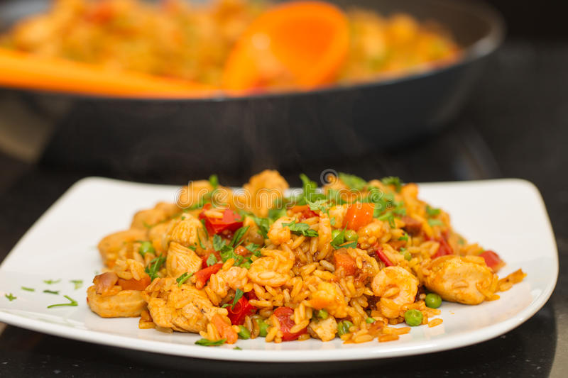 Paella on a plate, still steaming stock photo