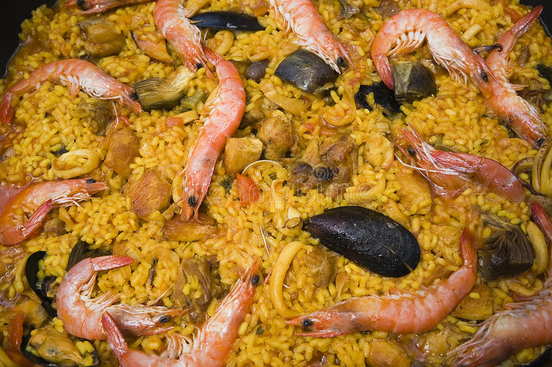 Paella with prawns and mussels, typical Spanish dish, ingredients of the Mediterranean stock photos