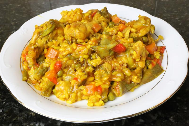 Paella of rice with chicken and vegetables. Typical of the Andalusian and Spanish gastronomy stock images