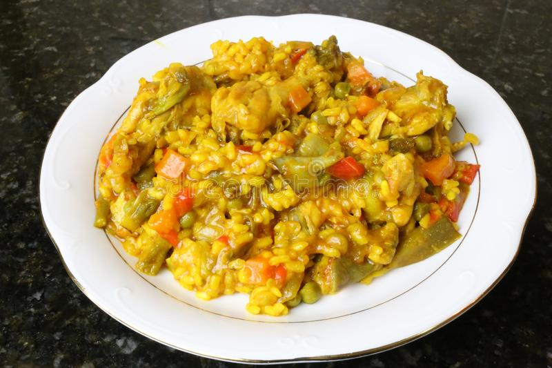 Paella of rice with chicken and vegetables. Typical of the Andalusian and Spanish gastronomy stock image