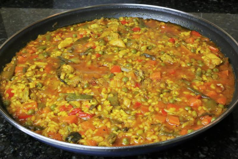 Paella of rice with chicken and vegetables. Typical of the Andalusian and Spanish gastronomy stock photo