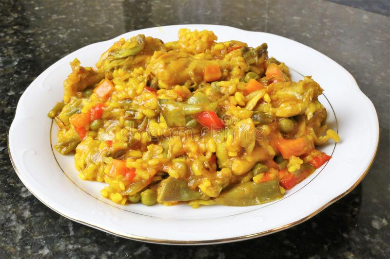 Paella of rice with chicken and vegetables. Typical of the Andalusian and Spanish gastronomy royalty free stock photos