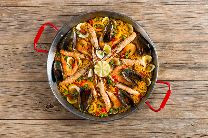 Paella with seafood and vegetables royalty free stock photo