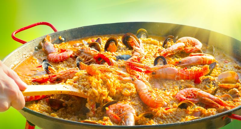 Paella. Traditional spanish food, seafood paella with mussels, king prawns, langoustine and squids. Paella. Traditional spanish food, seafood paella in the fry royalty free stock photos