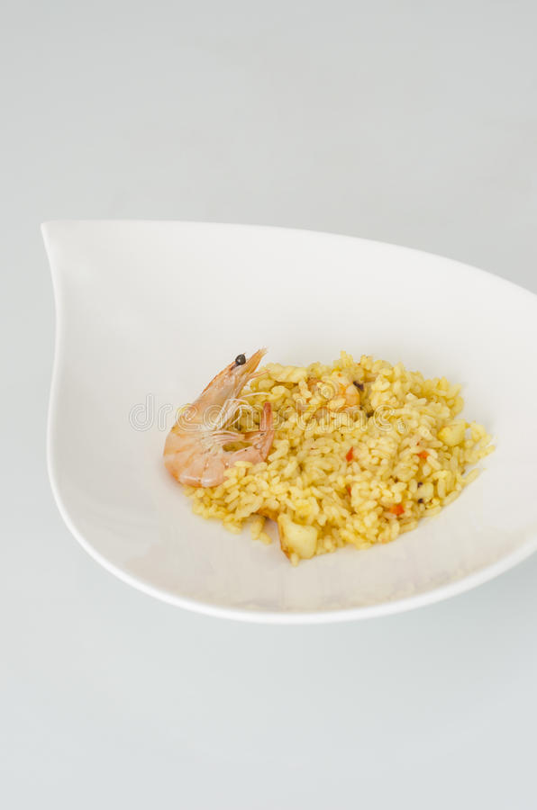 Paella, typical Spanish dish on white background. royalty free stock images