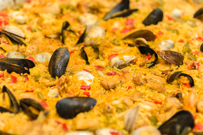Paella Valenciana rice with saffron and seafood royalty free stock photography