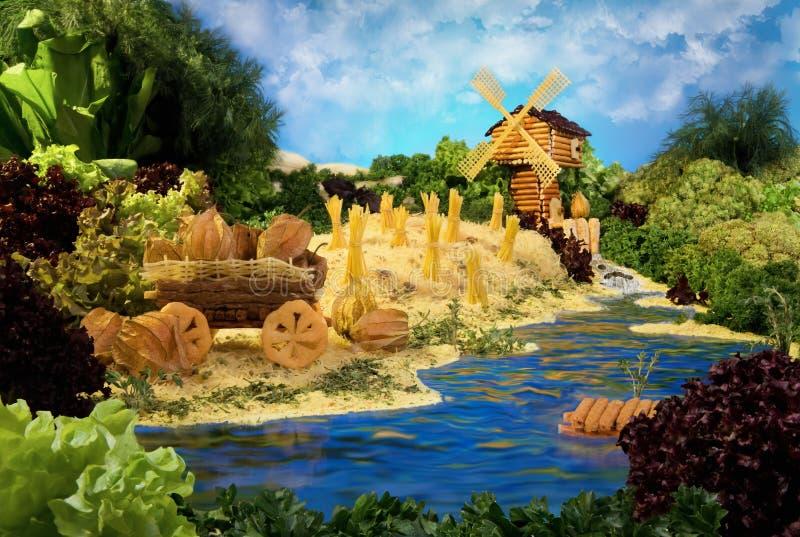Paesaggio con il mulino a vento fatto da alimento immagini stock