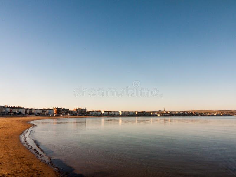 paesaggio della natura di tramonto della spiaggia degli azzurri della costa di mare di Dorset del weymouth fotografie stock libere da diritti
