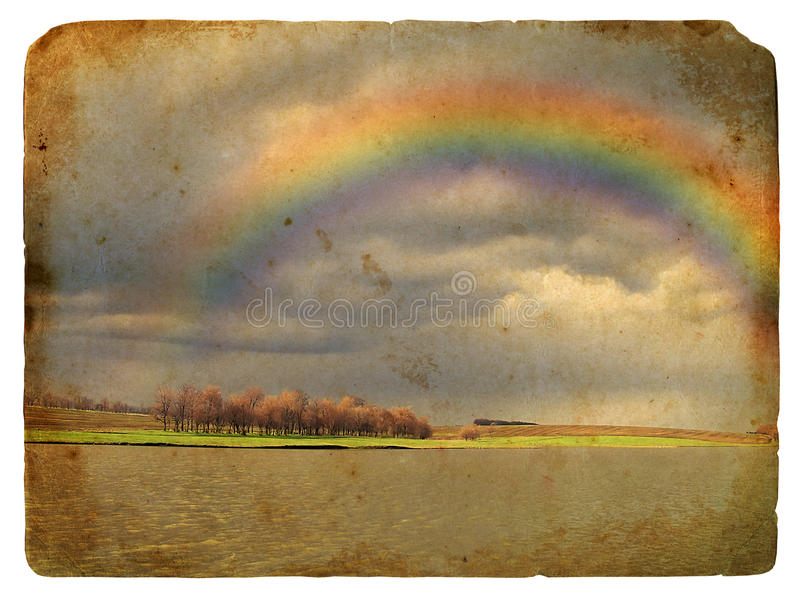 Paesaggio della sorgente con il Rainbow. Vecchia cartolina. fotografie stock libere da diritti