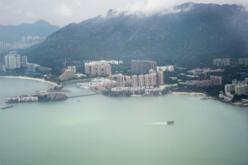 Paesaggio di vista aerea e paesaggio urbano dell'isola di Hong Kong dal volo di Airbus fotografie stock