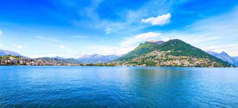 Paesaggio panoramico del lago lugano. Città e montagne. Il Ticino, svizzero, Europa fotografia stock