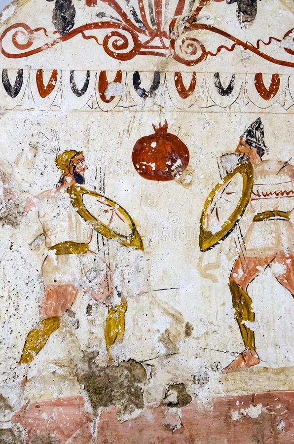 Paestum forntida frescoes i gravvalvet av att slåss krigare arkivbild