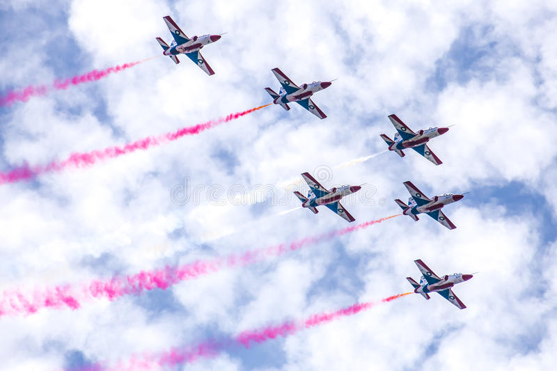PAF K-8 / Hongdu JL-8, Sherdils Aerobatics Team, Islamabad, Pakistan. PAF K-8 / Hongdu JL-8, Sherdils Aerobatics Team performing over Islamabad, Pakistan stock photo