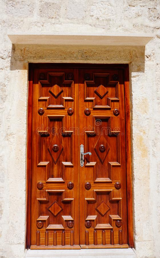 Door made of natural wood on the Benedictine monastery of Saint Margarita in the town of Pag, on the Croatian island of Pag. Pag, Croatia, July 8, 2019. Wooden royalty free stock images