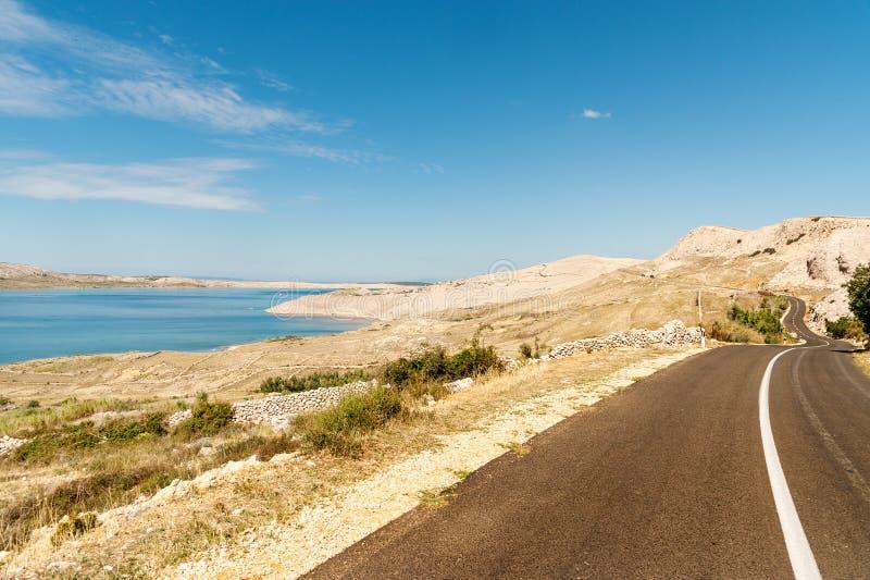 Pag island road. Road winding through Pag island with typical landscape, Adriatic coast, Dalmatia, Croatia stock image