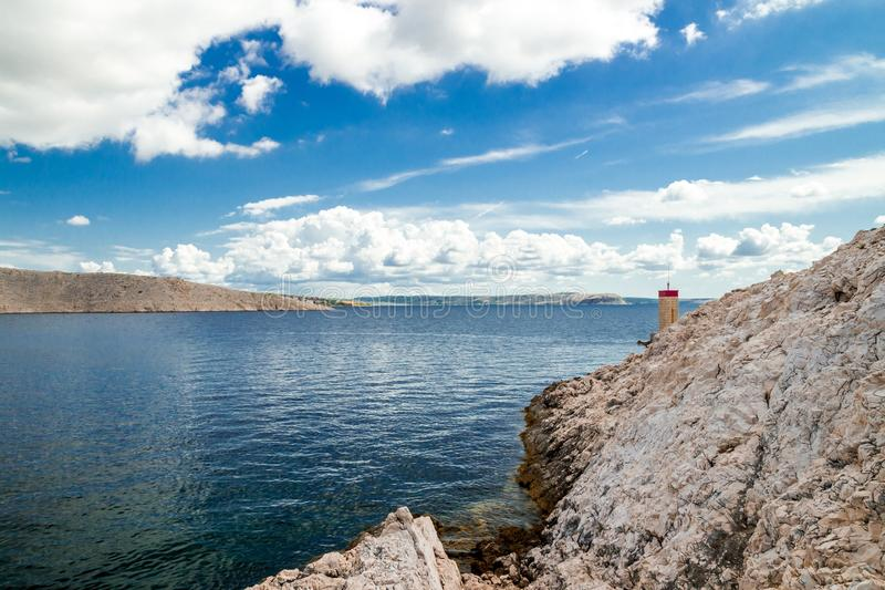 Pag island and summer clouds, Croatia royalty free stock photos