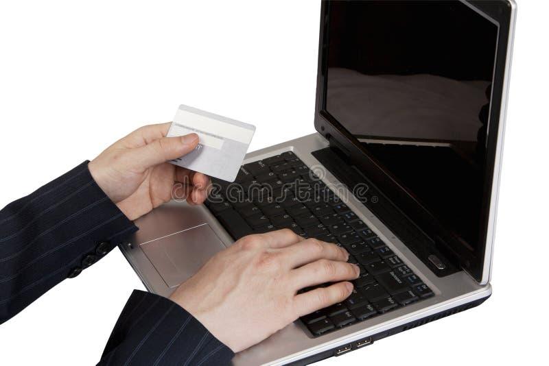 Pagamento di carta di credito sul computer portatile immagine stock libera da diritti