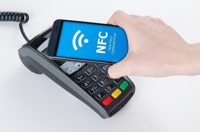 Pagamento móvel com tecnologia de NFC fotografia de stock royalty free