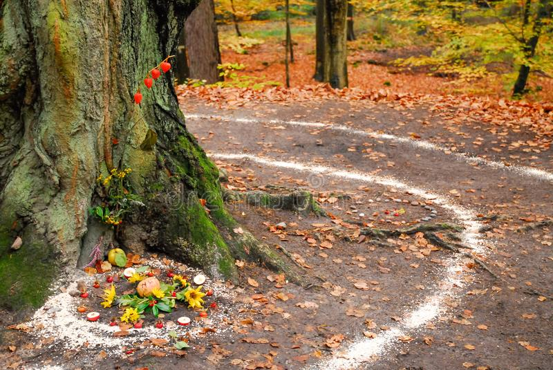 Pagan altar and spiral works outside next to a tree. royalty free stock photography