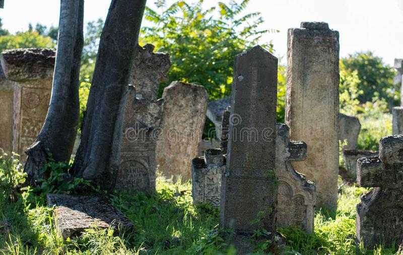 Pagan Tombstone in the village of Rajac, near Negotin, Serbia. Pagan cemetery and tombstone with strange symbols in the village of Rajac, near Negotin, Serbia stock images