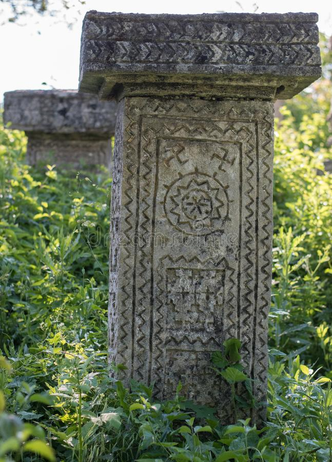 Pagan Tombstone in the village of Rajac, near Negotin, Serbia. Pagan cemetery and tombstone with strange symbols in the village of Rajac, near Negotin, Serbia stock photos
