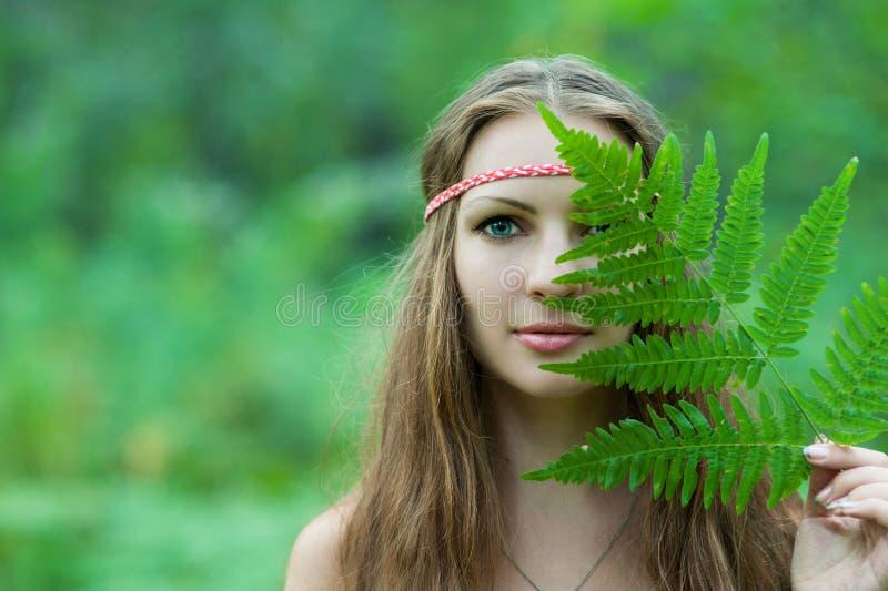Pagan girl closes her eyes fern. Slavic pagan girl closes her eyes fern stock photography