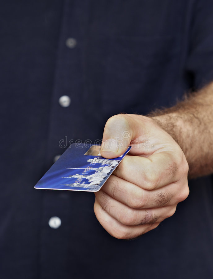 Pagando dalla scheda fotografie stock libere da diritti