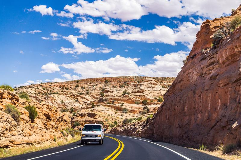 Delivery of goods to the USA. Post van on the highway US 89 royalty free stock photos
