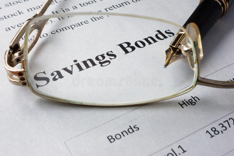 Page of newspaper with words savings bonds. royalty free stock photo