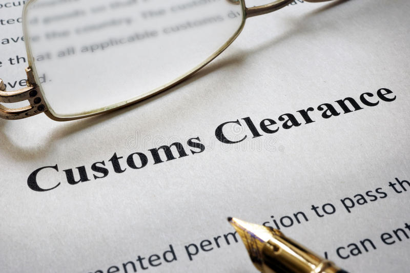 Page of paper with words Customs Clearance. Page of paper with words Customs Clearance and glasses stock image