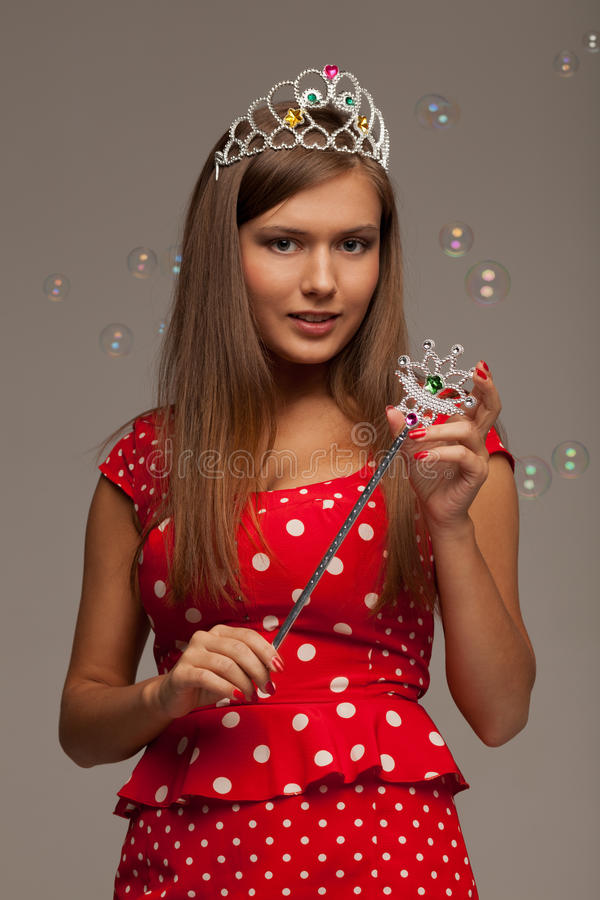 The pageant queen. With crown and sceptre royalty free stock photography
