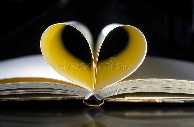Pages of book forming heart stock images