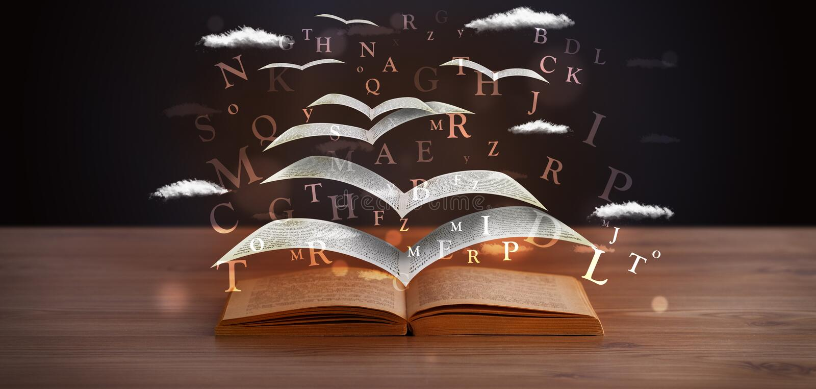 Pages and glowing letters flying out of a book stock image