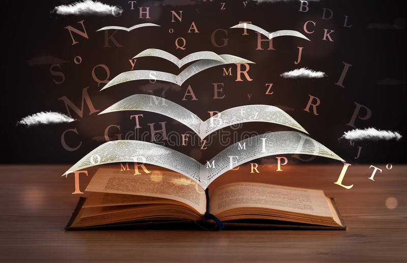 Pages and glowing letters flying out of a book. On wooden deck stock images