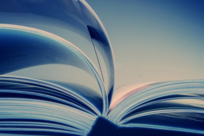 Pages of an open book. Blue tonality of the image. Business and finance. Business metaphor stock photos